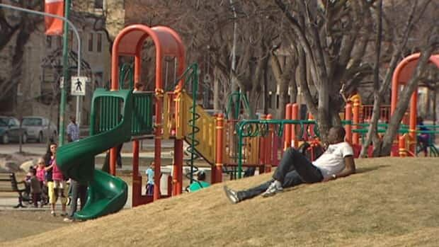People enjoy the warm weather at Central Park in downtown Winnipeg on Saturday. The temperature hit 19.2 C that day, shattering a record set in 1938.