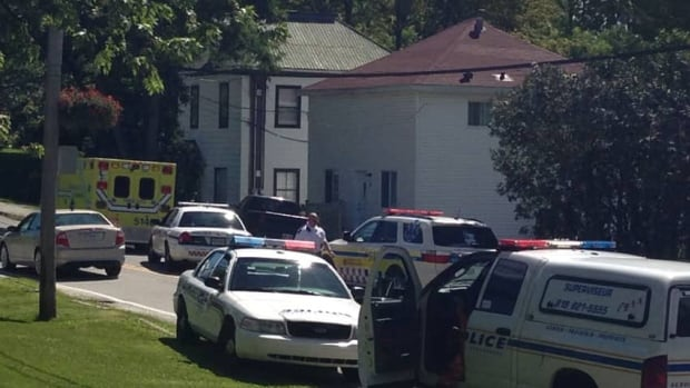 A man surrendered to police in Sherbrooke, Que. on Tuesday afternoon after barricading himself in a house for hours.