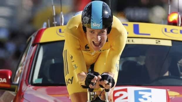 Bradley Wiggins of Britain, wearing the overall leader's yellow jersey, strains in the last metres to win the 9th stage of the Tour de France cycling race, an individual time trial over 41.5 kilometres on Monday.
