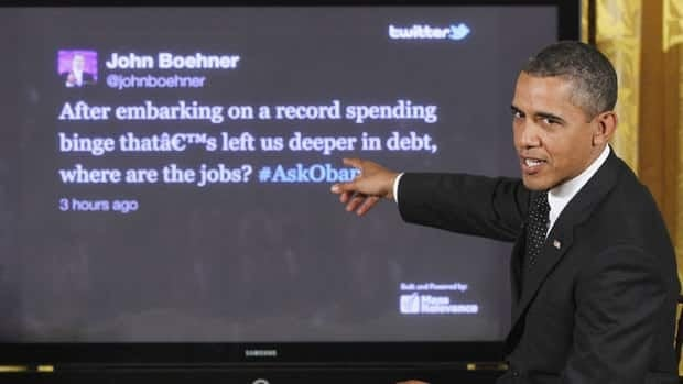"""U.S. President Barack Obama answers a tweet from Republican House Speaker John Boehner during a """"Twitter Town Hall"""" in the East Room of the White House in Washington last July."""