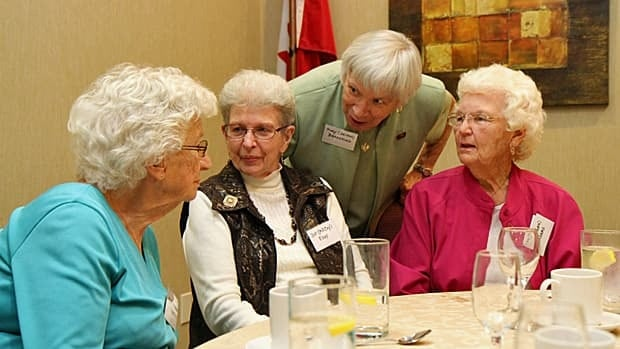 Mary Gent of Peterborough, Dorthea Eddy of Oakville, Mary Beresford of New Jersey and Kay Adams of Mount Hope share a laugh at the 65th annual reunion of the Hamilton General Hospital nursing class of 1947. (Samantha Craggs/CBC)