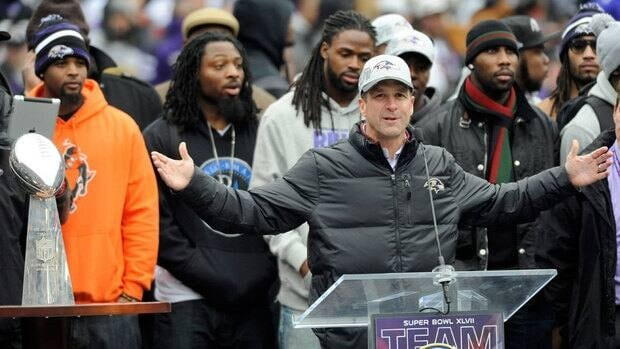 Baltimore Ravens head coach John Harbaugh addresses fans during a celebration of the team's Super Bowl championship at M&T Bank Stadium on Tuesday.