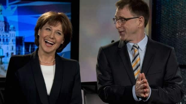 Liberal leader Christy Clark and NDP's Adrian Dix, looking a bit like game show hosts, pose for a pre-debate photo Monday night.