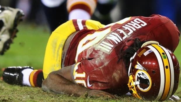 Washington Redskins quarterback Robert Griffin III is injured on this play as he fumbles a low snap in the fourth quarter against the Seattle Seahawks during the NFC Wild Card Playoff Game at FedExField on January 6. Griffin was previously playing injured.