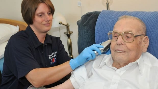 An Extended Care Paramedic treats an elderly patient in Nova Scotia as part of a two-year pilot program that aims to cut down on seniors' use of ambulances.