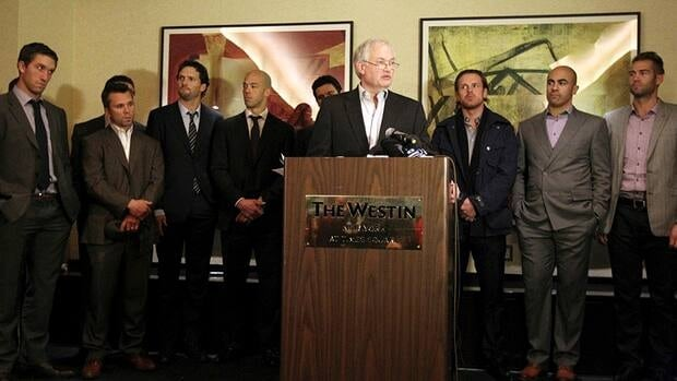 Donald Fehr, executive director for the NHLPA, is surrounded by hockey players as he speaks to reporters on Thursday, Dec. 6, 2012 in New York. Following the press conferences by Fehr and NHL Commissioner Gary Bettman, fans responded to the day's events on Twitter.