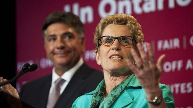 Ontario Premier Kathleen Wynne speaks about the budget alongside Finance Minister Charles Sousa at Queens Park in Toronto.