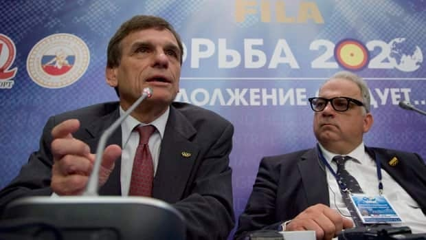 Nenad Lalovic, right, and Stan Dziedzic, left, of the international wrestling federation FILA, seen speaking in Moscow on May 18, feel the organization has made positive changes to the sport.
