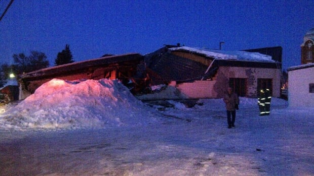 Fire crews in Melville, Sask. say this building collapsed Tuesday evening because of heavy snow on the roof.