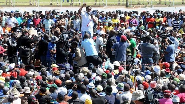Julius Malema addresses thousands of striking mineworkers at the Goldfields Mine at Grootfontein, South Africa.