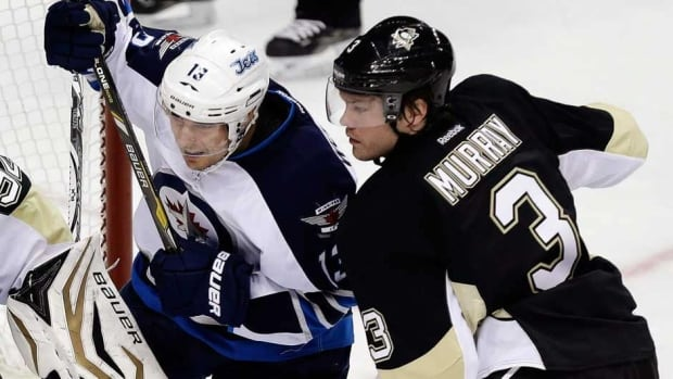 Pittsburgh Penguins defenceman Douglas Murray, right, was acquired by the team from the San Jose Sharks last week.