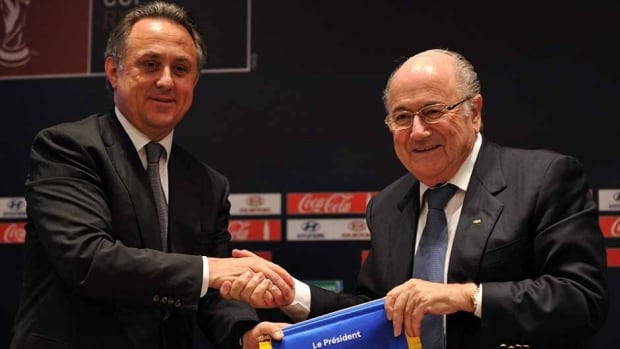 FIFA president Sepp Blatter, right, shakes hands with Russian Sports Minister Vitaly Mutko, left, last fall at a news conference.