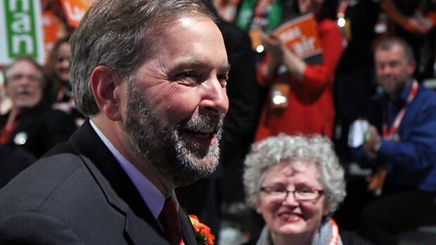 Thomas Mulcair reacts with a smile after the announcement of the results of the third ballot.