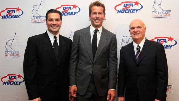 Hockey greats Eddie Olczyk, left, Mike Modano and Lou Lamoriello, right, pose for a photo before the U.S. Hockey Hall of Fame class of 2012 induction dinner Monday in Dallas.
