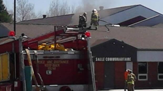Firefighters were called to the building around 11:13 a.m. Saturday with reports that smoke was seen at the top of the building.
