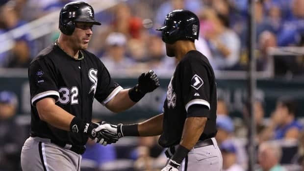 Adam Dunn, left, of the Chicago White Sox celebrates his two-run home run with Alex Rios  during a game against against the Kansas City Royals on Saturday.
