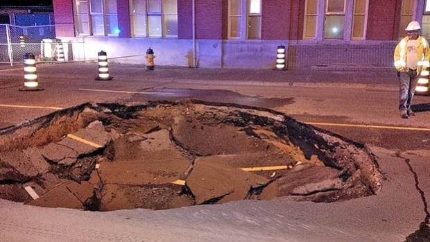 Sudbury officials are reporting a watermain break is behind a massive sinkhole that opened up on Elgin Stree early Monday morning.