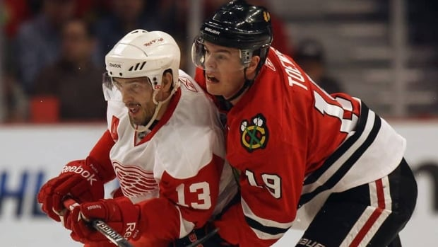 Pavel Datsyuk, left, and Jonathan Toews, right, were both nominated for the Selke Trophy on the same day their teams meet for Game 1 of their Western Conference semifinal series.