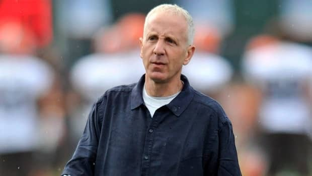 Cleveland Browns owner Randy Lerner walks on the field during training camp in Berea, Ohio, Saturday, July 28, 2012.