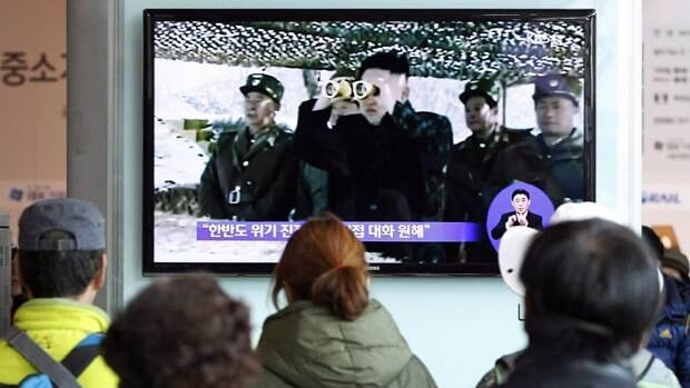 South Koreans watch a TV program showing North Korean leader Kim Jong-un at Seoul Railway Station on April 7.