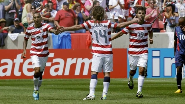 United States' Kyle Beckerman (14) celebrates with teammates Chris Wondolowski (19) and Edgar Castillo (2) after Wondolowski scored his second goal during the second half of their CONCACAF Gold Cup match Saturday against.