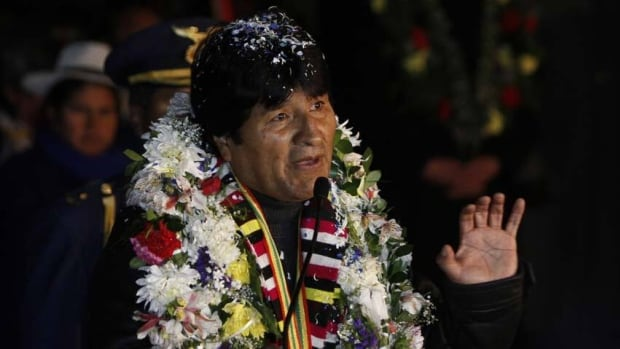 Bolivia's President Evo Morales returned home to a hero's welcome late Wednesday, furious with the U.S. after his plane was forced to land in Austria.
