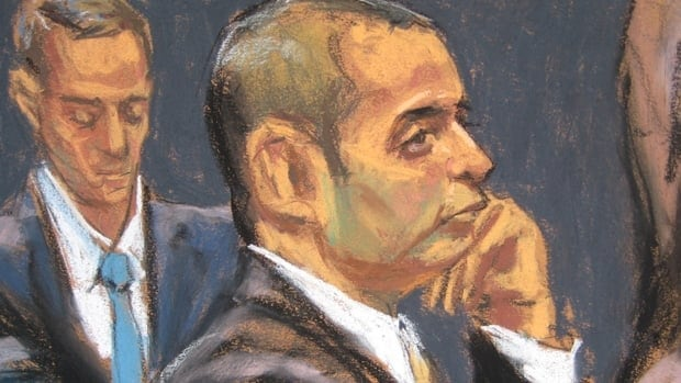 Former New York City police officer Gilberto Valle, dubbed by local media as the 'cannibal cop', appears in this courtroom sketch during opening arguments of his federal trial in New York.