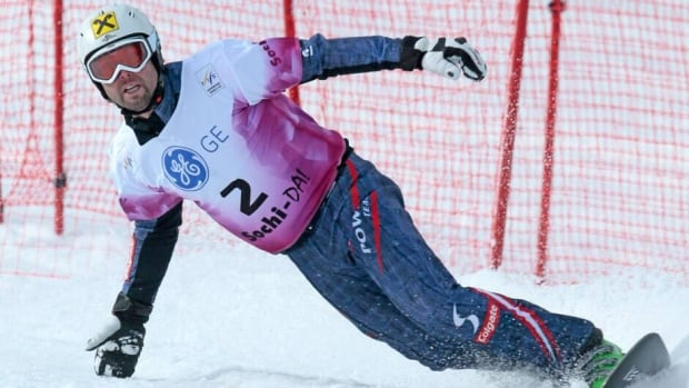 Andreas Prommegger, shown here competing on Thursday, won a snowboard World Cup parallel giant slalom event on Saturday.