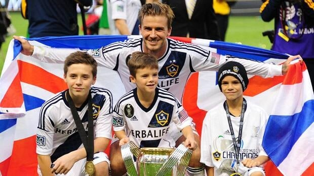 Brooklyn Beckham, left, is shown with father David and brothers Romeo, centre, and Cruz, right, after the Los Angeles Galaxy won the MLS title on Dec. 1. Robyn Beck/AFP/Getty Images