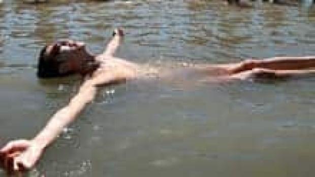 mi-bc-120911-wreck-beach-bather