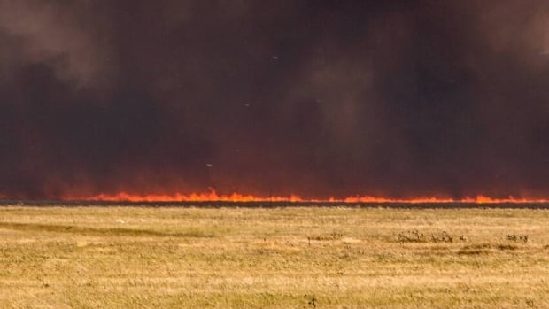 A grass fire spreads across the Blood Reserve west of Lethbridge in this file photo. Crews in Rocky View County responded to half a dozen grass fires on Thursday afternoon.