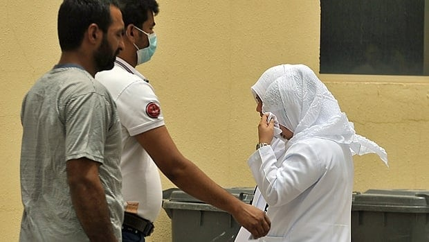 Saudi nurses and citizens walk outside the King Fahad hospital in Hofuf. The virus spreads easily in hospitals, researchers have found.