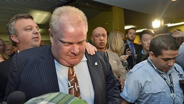 Toronto Mayor Rob Ford walks to attend a charity event in Toronto on Monday, the day a judge ruled he broke conflict of interest rules.