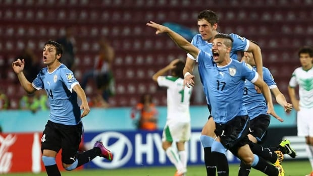 Uruguay players celebrate their victory over Iraq on July 10, 2013.