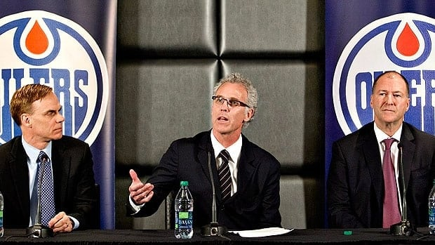 New general manager Craig MacTavish, centre, is flanked by new senior vice president of hockey operations Scott Howson, left, and team president Kevin Lowe.