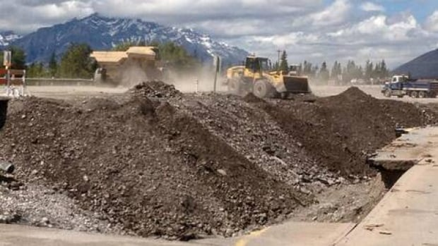Two lanes of the Trans-Canada Highway near Canmore, Alta., have reopened while road crews continue to repair the flood damage.