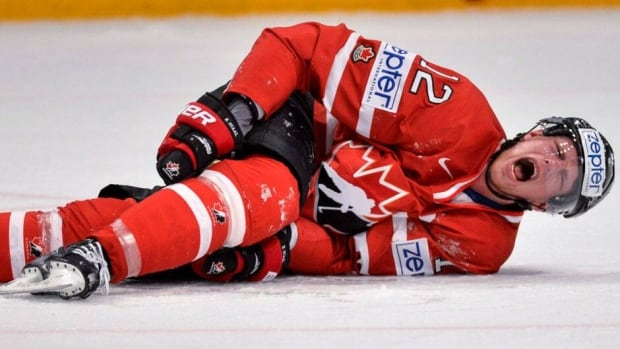 Canada's Eric Staal, shown here after a knne-on-knee collision with Sweden's Alex Edler on Thursday, was diagnosed with a third-degree MCL sprain.
