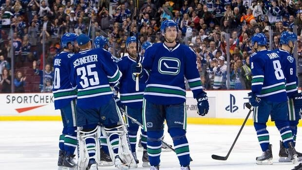 Vancouver Canucks players celebrate their second consecutive Presidents' Trophy honour with their fans Saturday night at Rogers Arena.