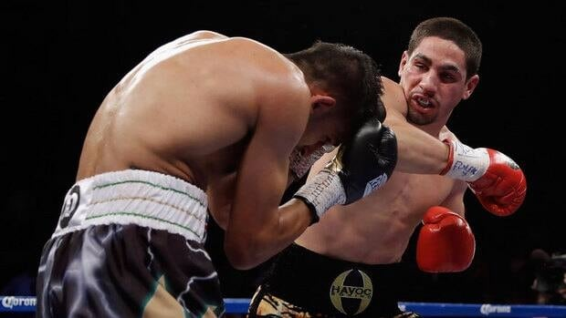 Danny Garcia, right, throws a right hand at Amir Khan during their super lightweight bout Saturday night.