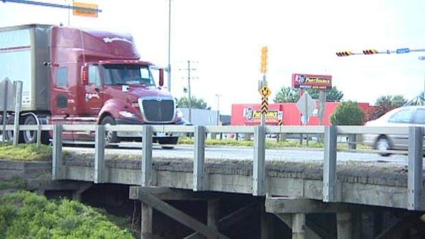 Large trucks, which may or may not be fully-loaded, continue to use a bridge with weight restrictions.