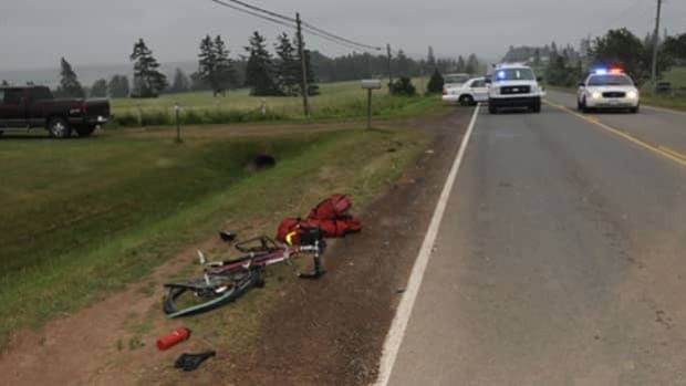 An Alberta woman was killed when she was struck by a van while on her bicycle on Route 13.