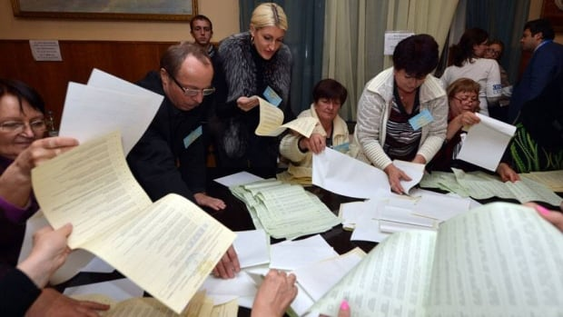 Electoral commission members count ballots in Kyiv on Sunday. International observers have denounced the parliamentary election as unfair.