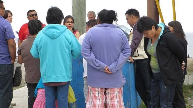 People gathered outside the Innu Nation Office in Sheshatshui, Labrador.
