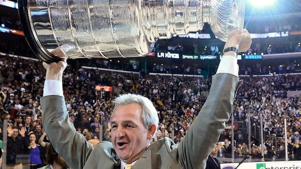 Los Angeles Kings coach Darryl Sutter hoists the Stanley Cup after beating the New Jersey Devils in Game 6 of the Stanley Cup finals on Monday. One day later, Sutter's ready to start all over.