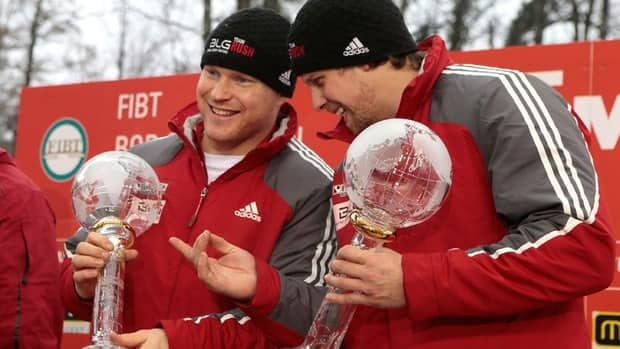 Lyndon Rush, left, and Jesse Lumsden clinched bobsleigh's World Cup two-man season title on Feb. 16 on the Sochi Olympics track.