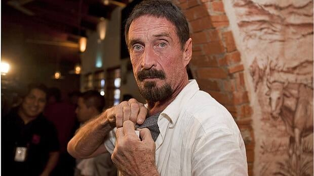Software company founder John McAfee adjusts a microphone in preparation for an interview in Guatemala City on Dec. 4, 2012.