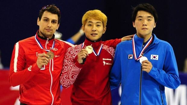 Guillaume Bastille of Canada, left, Viktor An of Russia, centre, and Noh Jin-kyu of South Korea pose with their medals after the men's 1,500m final in Shanghai Saturday Dec. 8, 2012.