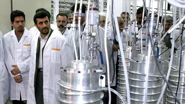 Iranian President Mahmoud Ahmadinejad (second from left) visits the Natanz nuclear enrichment facility, 350 kilometres south of Tehran, in April 2008.