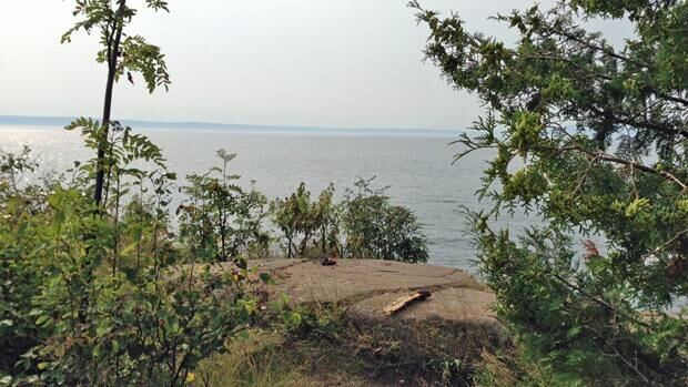 At the top of the cliff at Silver Harbour Conservation Area near Thunder Bay. No warning signs are posted.