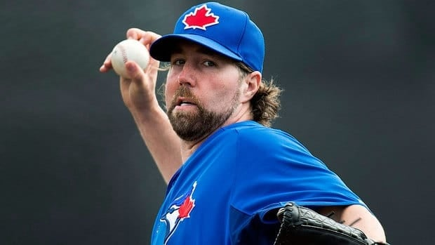 Blue Jays knuckleballer R.A. Dickey delivers in pre-season action against Boston on Monday in Dunedin. He gave up singles to three of the first four batters he faced in Toronto's 4-2 loss.